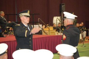 Clay receiving his first salute as a 2nd Lieutenant from brother, Phil Richardson