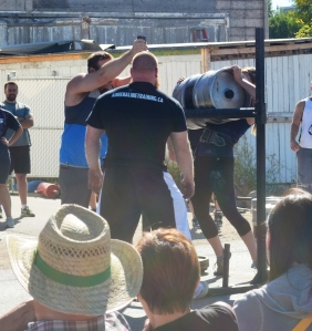 "Lindsay gets her 130lbs keg over a 50"" bar."