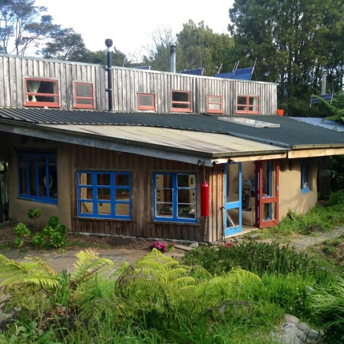 The owner's house, complete with solar electric, hot water and walls and floors built from recycled materials!