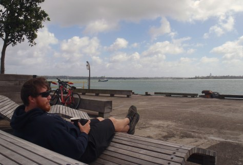 Clay relaxing on our first day in New Zealand - at one of the piers in Auckland Harbor