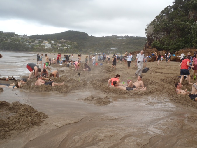 The craziness of the Hot Water Beach at low tide.