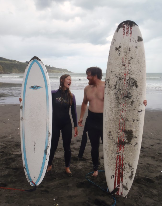 """Lindsay and I after a day of """"surfing""""... or trying"""