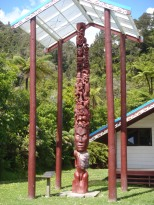 An intricately carved totem at the Mauri (native) village along the river.