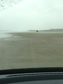 Following a minivan on the 90 mile beach.