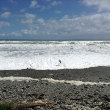 Clay taking a picture while Lindsay gets smoked by a 4' tall rogue wave... oops!