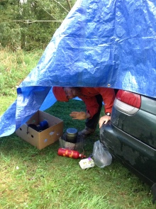 Cooking in the rain, one of our last days with Mushu