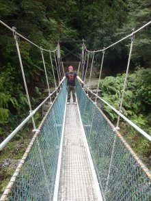 Crossing yet another swing bridge on our railway hike