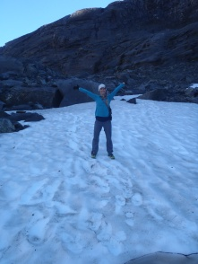 Lindsay standing on some snow in late March
