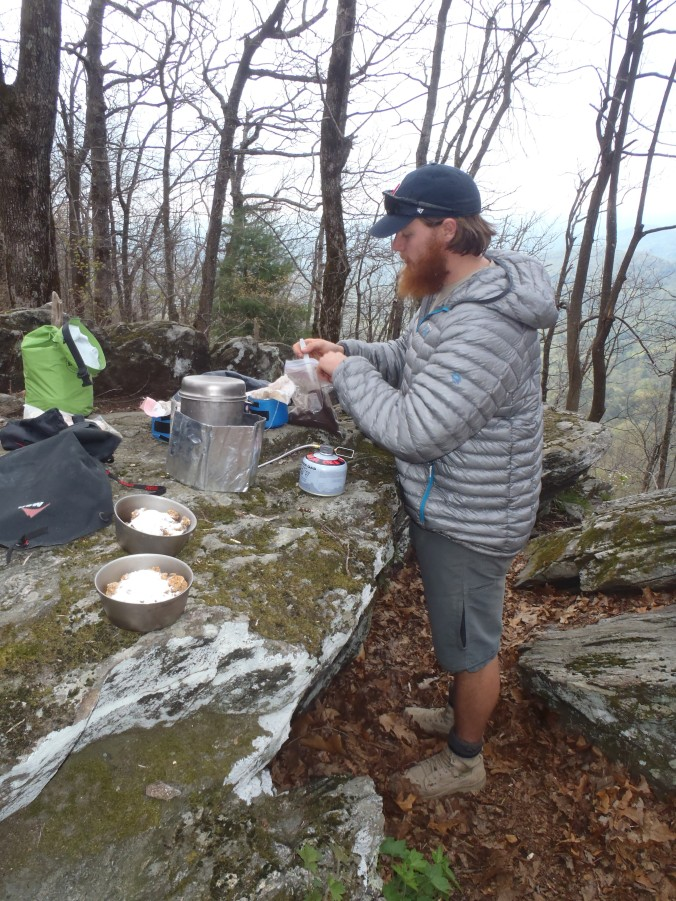 Close up of Clay cooking some breakfast while still in Georgia.