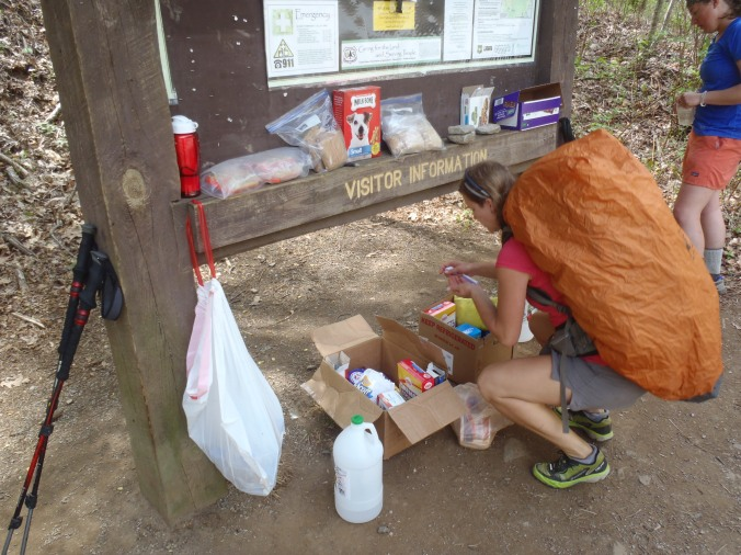 Lindsay diving into the mother-lode of trail magic. She didn't even drop her pack!