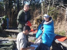 Lindsay getting checked out by the Park Rangers waiting for the ambulance.
