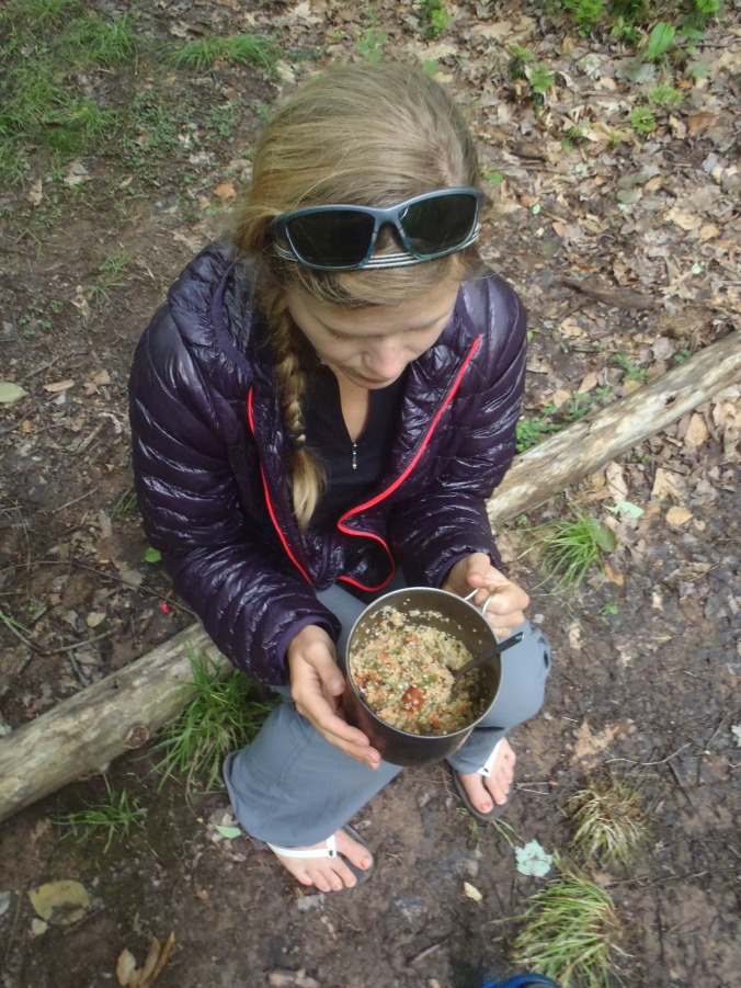 Action shot of Lindsay eating, likely some part of this was donated by section hikers.