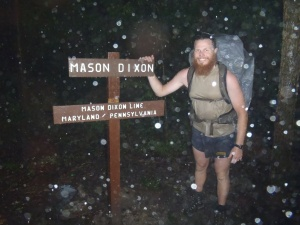 Clay posing at the Mason-Dixon line during a TORRENTIAL rain!