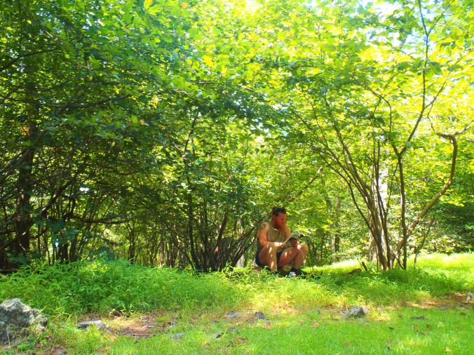 Clay taking a reading break on the trail in Pennsylvania