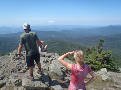 Lindsay and Bullfrog looking toward the White Mountains of New Hampshire from Killington Peak