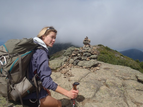 Lindsay heading into the unknown with Mt Lafayette in the clouds