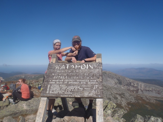 Lindsay cutting my beard off at the summit of Mt Katahdin, the end of our Appalachian Trail Journey