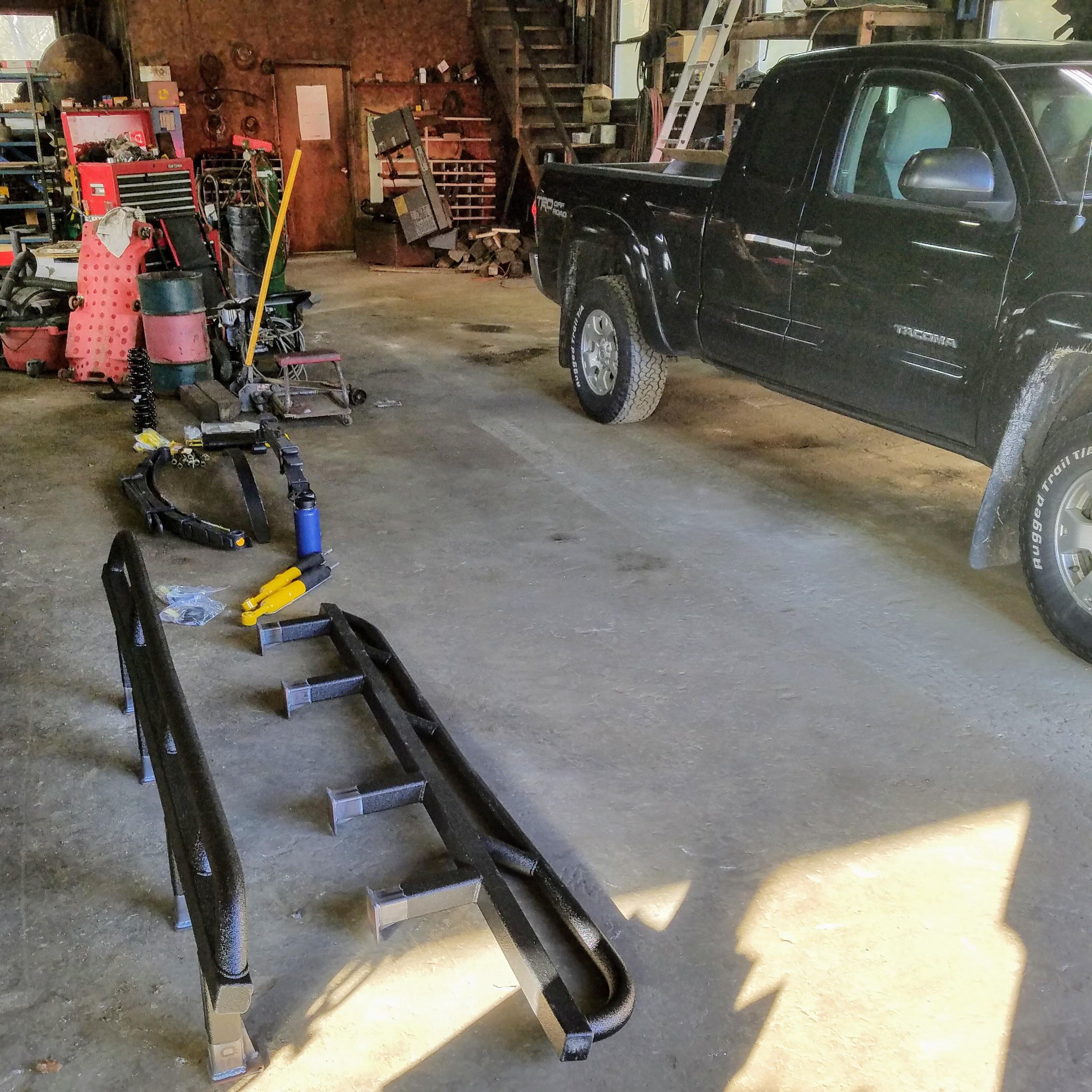 expedition overland truck build rock slider installation