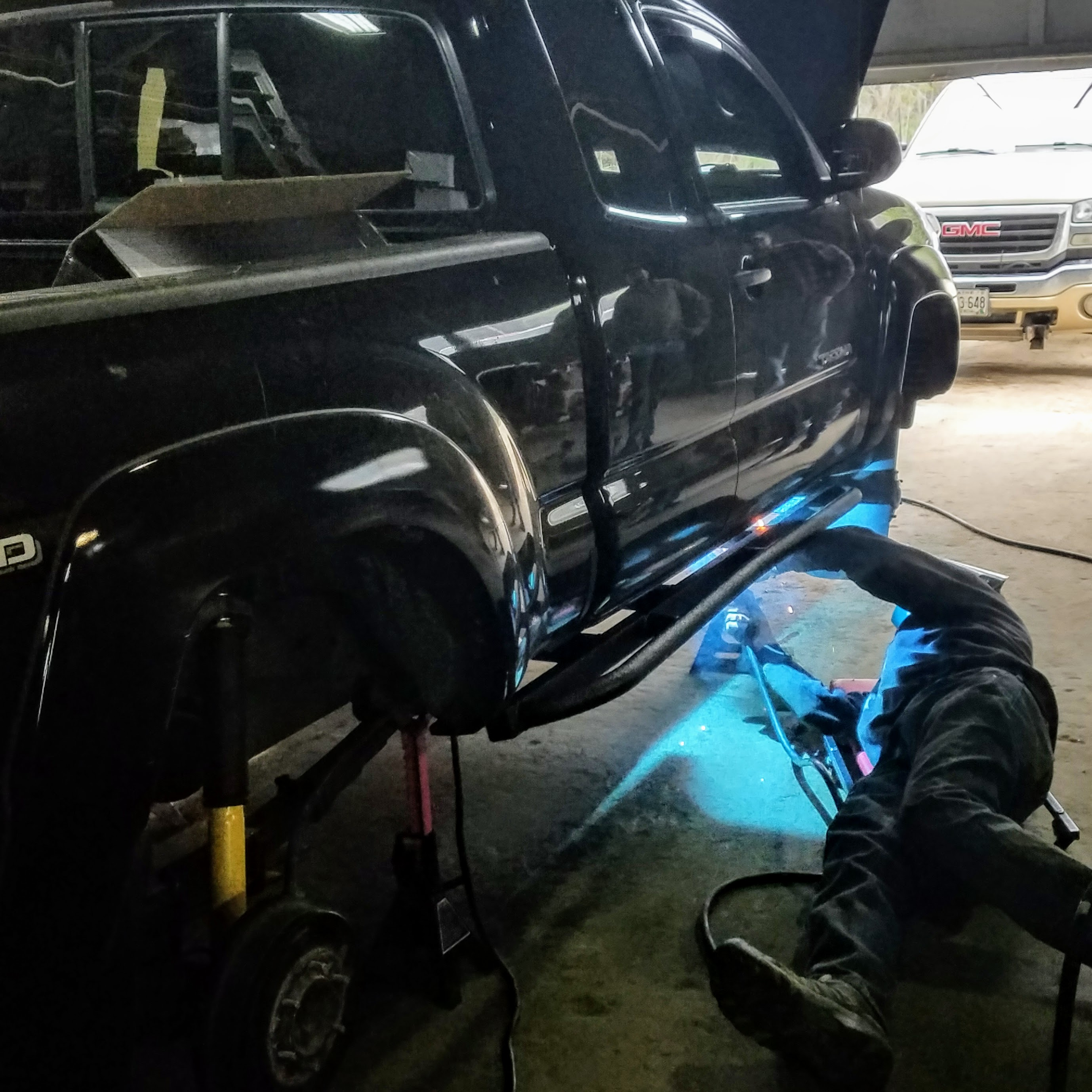 expedition overland truck build rock slider installation